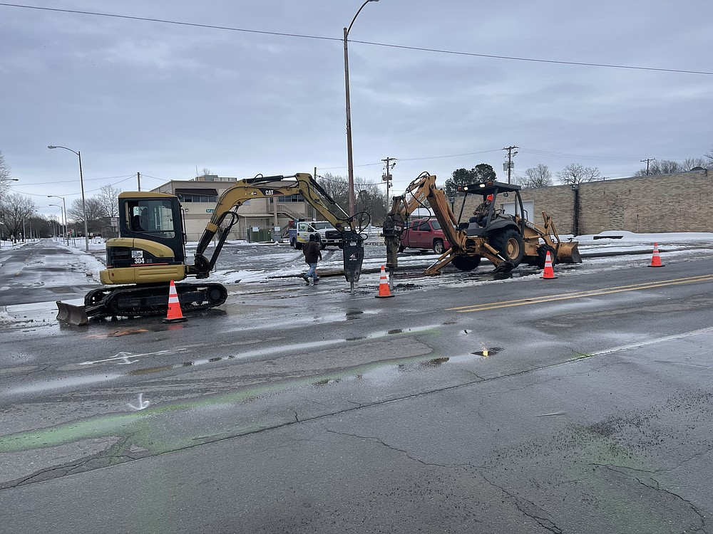 A crew with Pine Bluff Wastewater Utility work Sunday to fix a water leak in downtown Pine Bluff. (Special to The Commercial)
