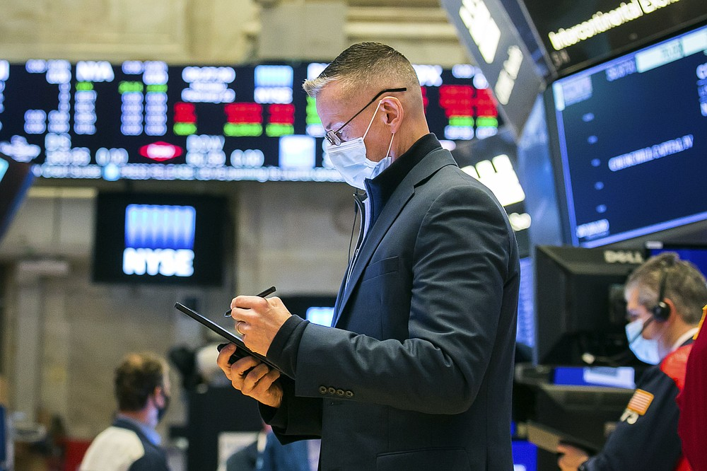 In this photo provided by the New York Stock Exchange, trader Neil Catania works on the floor, Monday Feb. 22, 2021. Investors remain focused on the future of global economies badly hit by COVID-19 and the potential for more stimulus to fix them.  (Courtney Crow/New York Stock Exchange via AP)