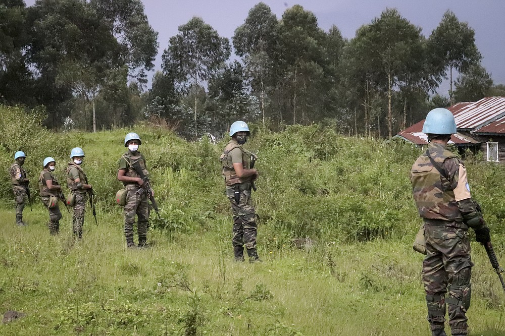 CORRECTS PHOTOGRAPHER BYLINE - United Nations peacekeepers guard the area where a U.N. convoy was attacked and the Italian ambassador to Congo killed, in Nyiragongo, North Kivu province, Congo Monday, Feb. 22, 2021. The Italian ambassador to Congo Luca Attanasio, an Italian carabineri police officer and their Congolese driver were killed Monday in an attack on a U.N. convoy in an area that is home to myriad rebel groups, the Foreign Ministry and local people said. (AP Photo/Justin Kabumba)