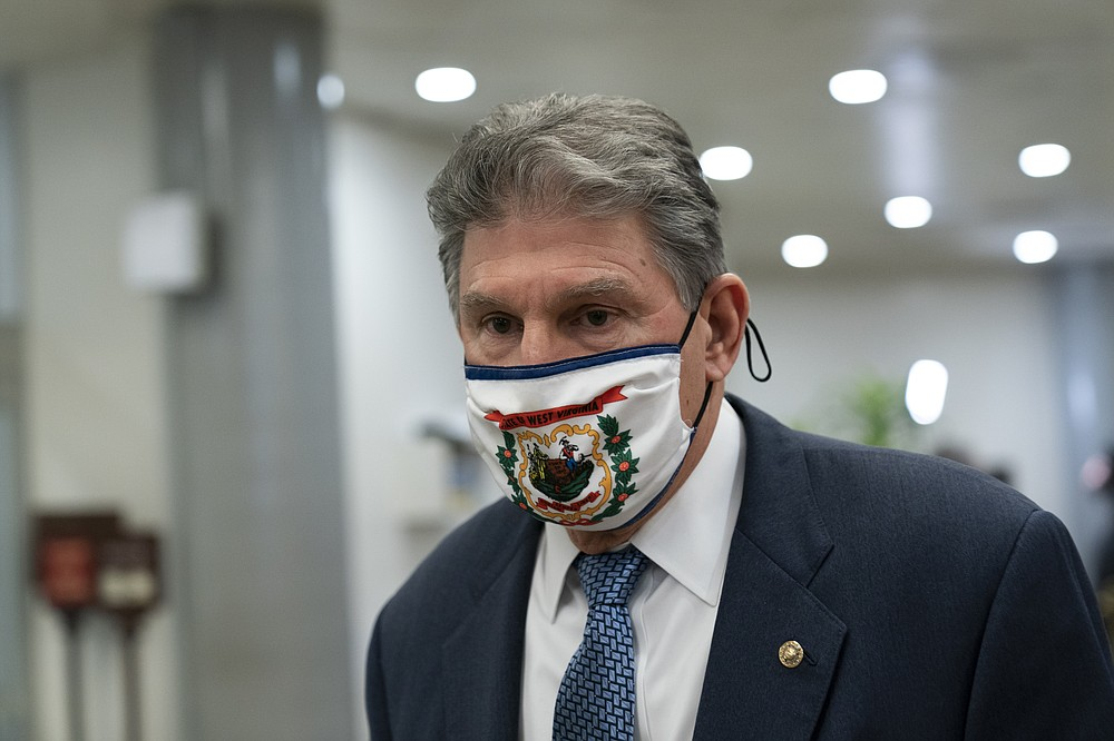 FILE - In this Feb. 13, 2021, file photo Sen. Joe Manchin, D-W.Va., departs on Capitol Hill in Washington. (AP Photo/Alex Brandon, File)