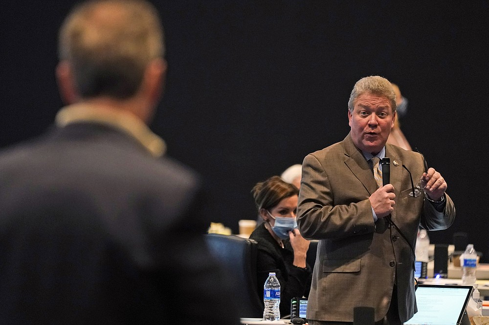 Virginia State Sen. Bill Stanley, R-Franklin County, gestures during debate on the death penalty abolition bill as Sen. Joe Morrissey, D-Richmond, left, listens at the Senate session at the Science Museum of Virginia in Richmond, Va., Monday, Feb. 22, 2021. The Senate passed the bill 22-18. (AP Photo/Steve Helber)