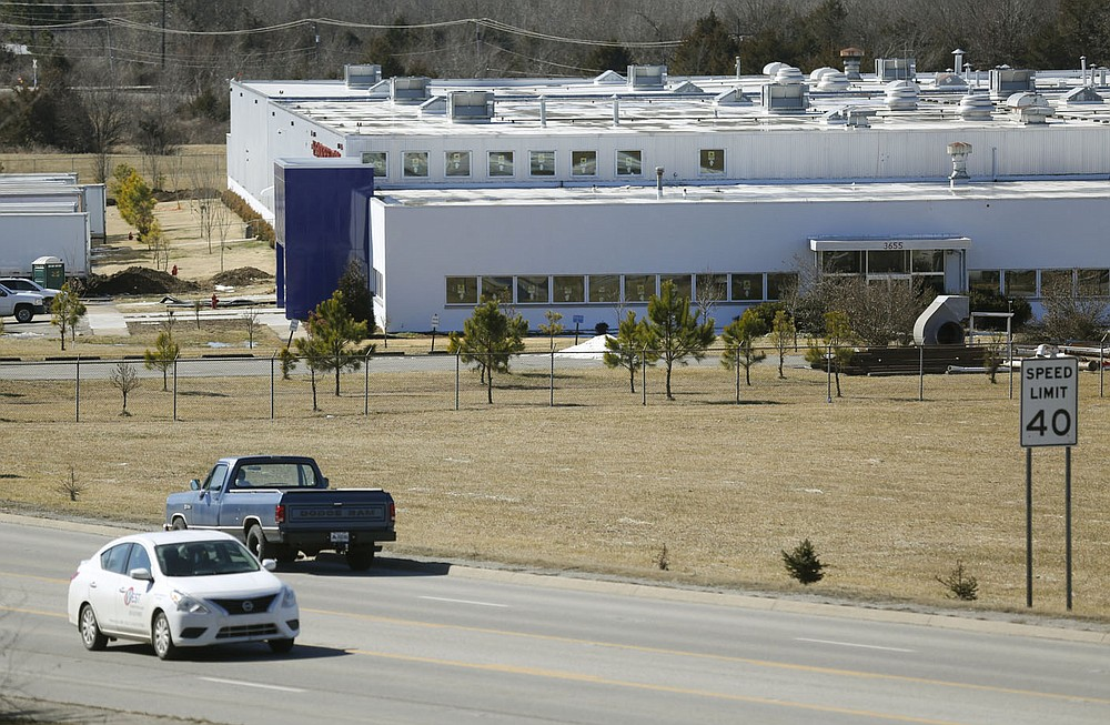 Traffic passes by the former Standard Register Co. building Monday, February 22, 2021, located at 3655 S. School Ave. in Fayetteville. Plans are in the works to turn the building into a 99,000-square-foot warehouse with a nearly 40,000-square-foot office and showroom. Check out nwaonline.com/210223Daily/ and nwadg.com/photos for a photo gallery. (NWA Democrat-Gazette/David Gottschalk)