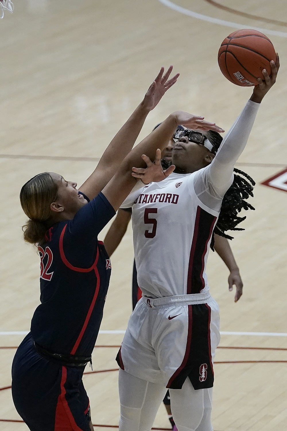 Stanford forward Francesca Belibi (5) shoots against Arizona forward Lauren Ware during the first half of an NCAA college basketball game in Stanford, Calif., Monday, Feb. 22, 2021. (AP Photo/Jeff Chiu)