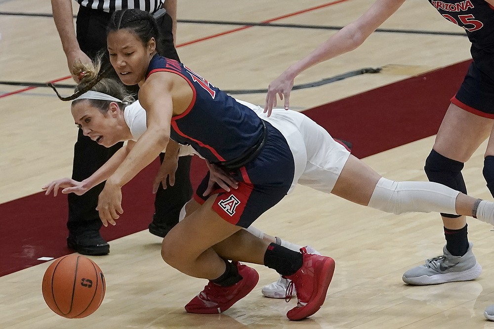 Arizona forward Sam Thomas, foreground, reaches for the ball in front of Stanford guard Lexie Hull during the first half of an NCAA college basketball game in Stanford, Calif., Monday, Feb. 22, 2021. (AP Photo/Jeff Chiu)