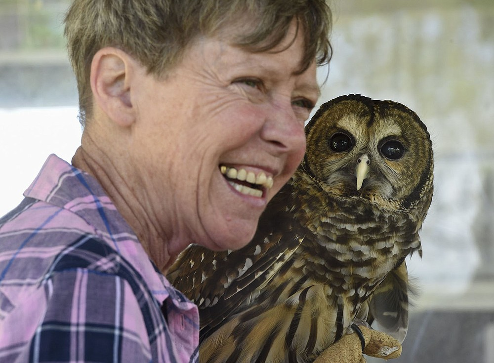 NWA Democrat-Gazette/CHARLIE KAIJO Lynn Sciumbato, operator of Morning Star Wildlife Rehabilitation Center, holds a barred owl during an annual Earth Day event, Saturday, April 27, 2019 at the Eagle Watch Nature Trail in Gentry.   Local 4-H club members and other participants began by working in gardens that promote butterflies and other pollinators. The program included presentations on raptors and other wildlife by Lynn Sciumbato, operator of Morning Star Wildlife Rehabilitation Center, and moths, butterflies and other pollinators by University of Arkansas Professor Don Steinkraus.