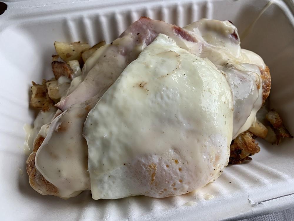Adding a fried egg to the Croque Ducrot from The Croissanterie makes it a Croque Madame. (Arkansas Democrat-Gazette/Eric E. Harrison)