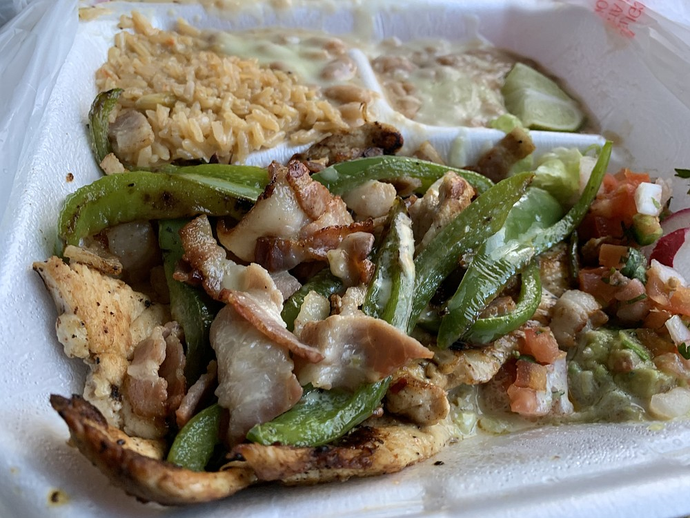 """El Torito's """"Torito's Special"""" features grilled chicken, green peppers, onions, bacon and cheese dip. (Arkansas Democrat-Gazette/Eric E. Harrison)"""