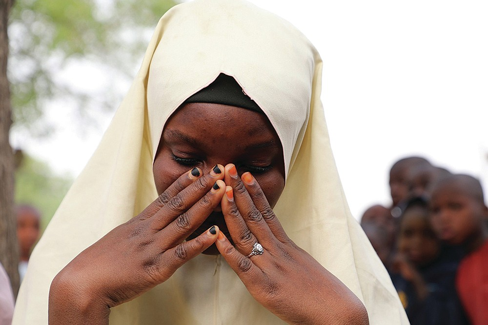 A student who survived the attack in which her schoolmates were taken is seen at the Government Girls Junior Secondary School in Jangebe. (AP/ Ibrahim Mansur)