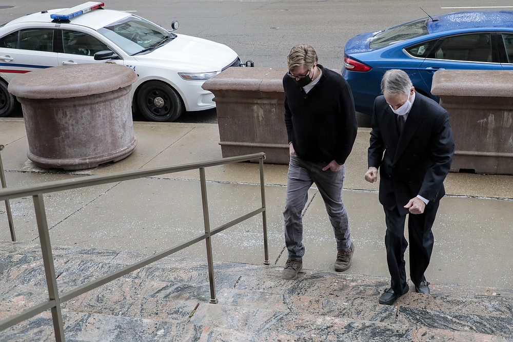 FILE - In this Jan. 25, 2021, file photo Dustin Thompson, left, of Columbus, who is accused of being part of the Jan. 6 insurrection at the U.S. Capitol, arrives with his lawyer, Sam Shamansky, to turn himself in at the Joseph P. Kinneary U.S. District Courthouse in Columbus, Ohio. (Joshua A. Bickel/The Columbus Dispatch via AP, File)