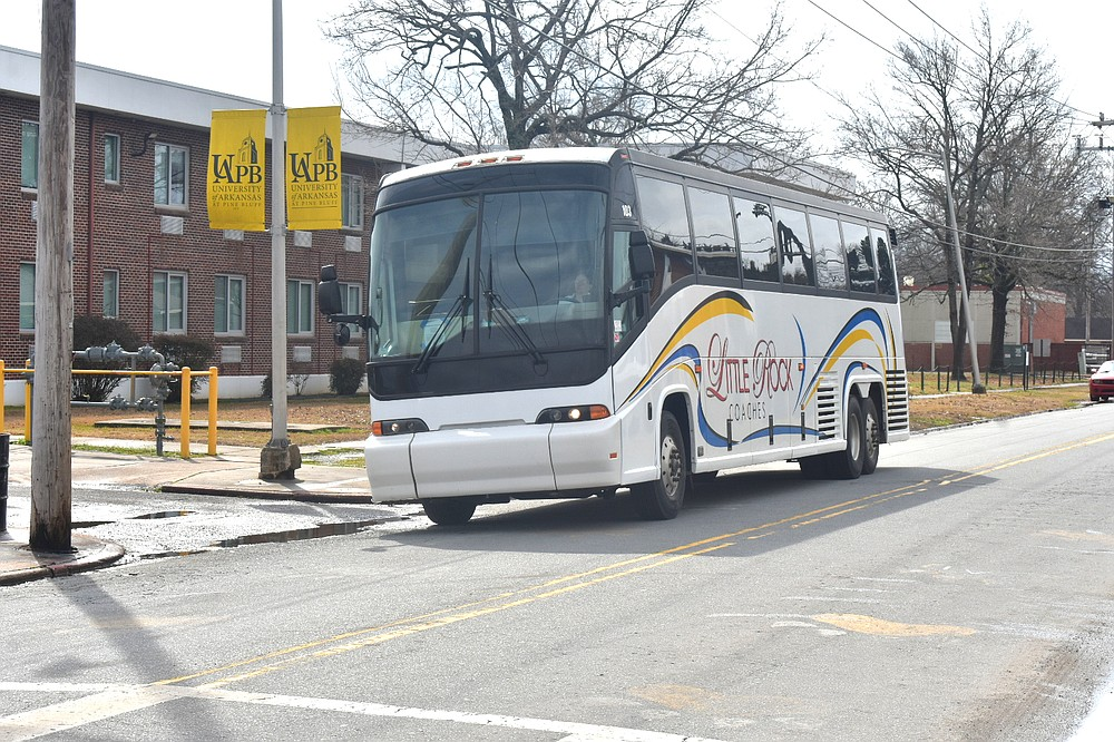 """A bus heads down L.A. """"Prexy"""" Davis Drive to Harrold Complex at the University of Arkansas at Pine Bluff on Sunday, Feb. 28, 2021. Students who were displaced from campus due to water pressure issues stemming from the Feb. 14-17 snowstorm returned to campus. (Pine Bluff Commercial/I.C. Murrell)"""