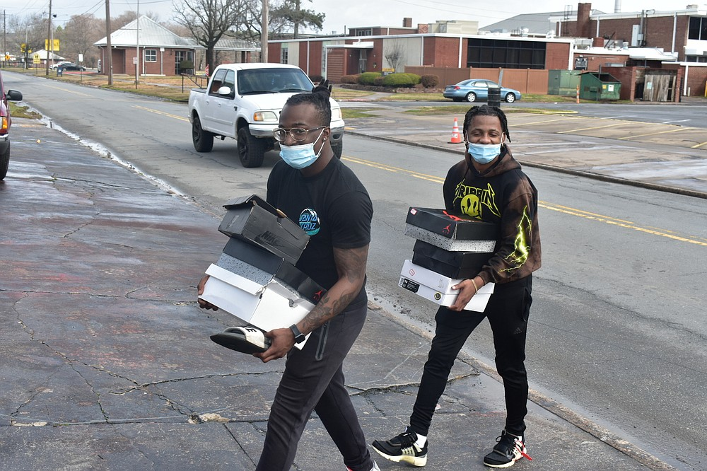 From left, Marcus Goree, 19, and Kameron Collins, 18, both of Memphis, return their belongings back to Harrold Complex at the University of Arkansas at Pine Bluff on Sunday, Feb. 28, 2021, after coming back from a Pine Bluff hotel. (Pine Bluff Commercial/I.C. Murrell)