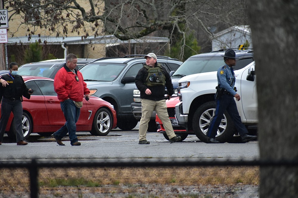 Law enforcement personnel pace the campus of Watson Chapel Junior High School on Monday, after responding to a call of a shooting that left a 15-year-old boy in serious condition. (Pine Bluff Commercial/I.C. Murrell)
