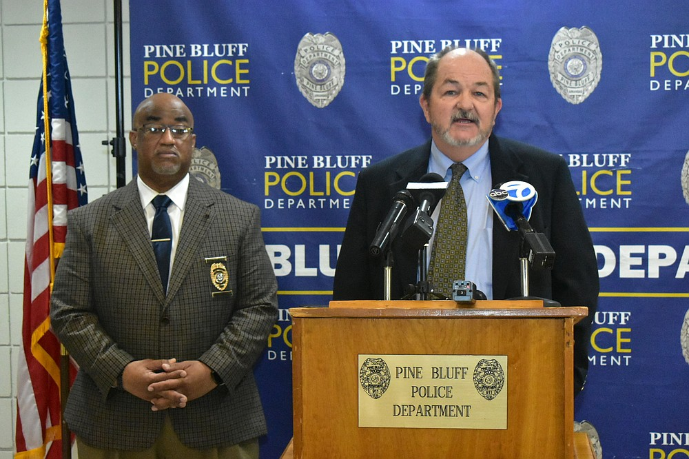 Jefferson County Prosecuting Attorney Kyle Hunter, right, tells local the media his office had not yet decided whether to charge a 15-year-old suspect in a shooting at Watson Chapel Junior High School as a juvenile or adult during a news conference on Monday, at the Pine Bluff Police Department headquarters. Also pictured is Pine Bluff Police Chief Kelvin Sergeant. (Pine Bluff Commercial/I.C. Murrell)