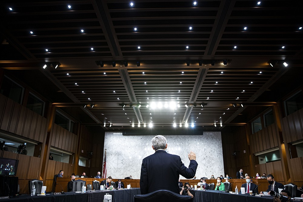 Judge Merrick Garland, nominee to be Attorney General, is sworn in at his confirmation hearing before the Senate Judiciary Committee, Monday, Feb. 22, 2021 on Capitol Hill in Washington.  (Al Drago/Pool via AP)