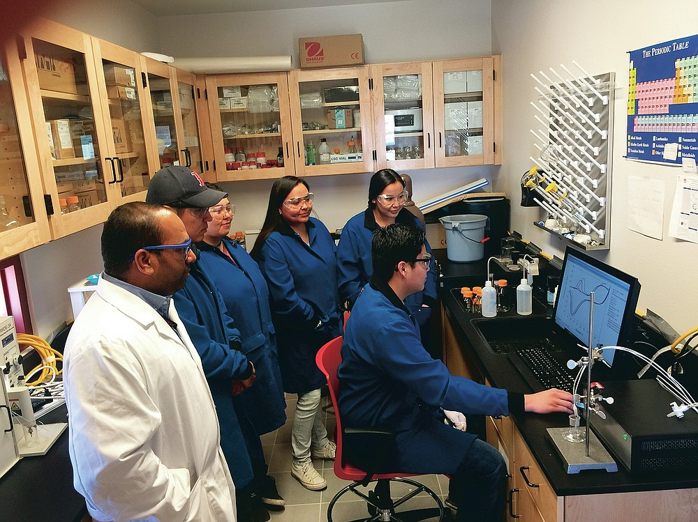 This undated image provided by Dr. Thiagarajan Soundappan shows members of a student research team working in the Electrochemistry Research Laboratory at Navajo Technical University in Crownpoint, N.M. Soundappan's former student, Robinson Tom, is currently conducting research at Harvard University. (Thiagarajan Soundappan via AP)