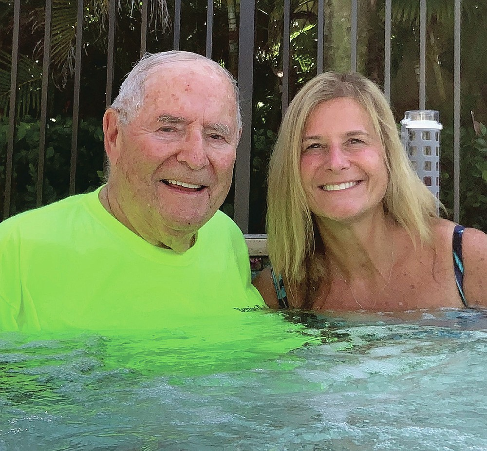 In this March 4, 2020 photo, Bernie Rubin, 82, sits with daughter Michelle Pepe in a hot tub in Boynton Beach, Fla. Rubin died the following month from COVID-19. (Michelle Pepe via AP)