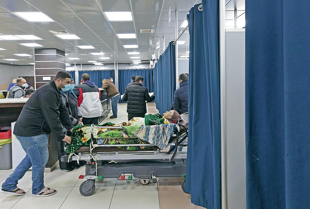A Palestinian patient infected with COVID-19 is admitted for medical observation at the emergency unit, in the Palestine Medical Complex, in the West Bank city of Ramallah, Tuesday, March 2, 2021. (AP Photo/Nasser Nasser)