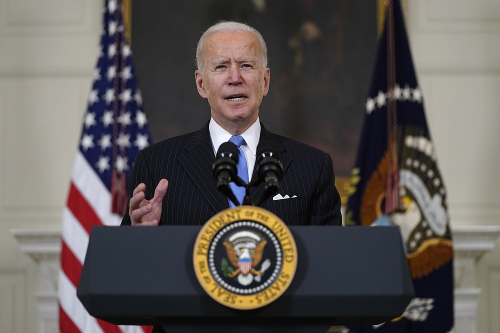 The Associated Press President Joe Biden speaks about efforts to combat COVID-19 in the State Dining Room of the White House on Tuesday in Washington.