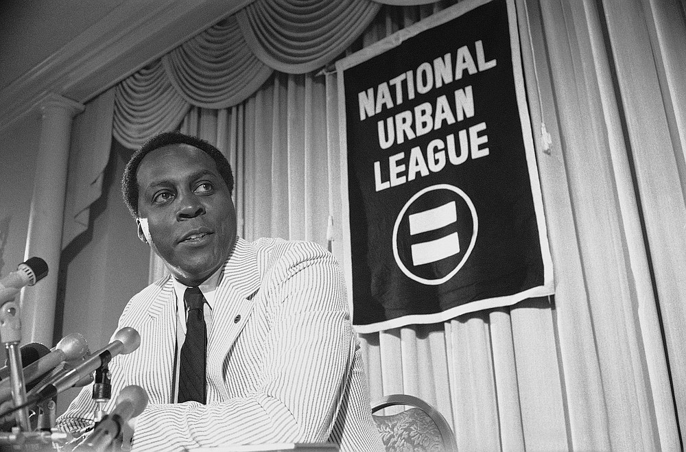 FILE - In this July 27, 1977 file photo, Vernon Jordan, President of the National Urban League, talks to reporters during a press conference in Washington.  Jordan, who rose from humble beginnings in the segregated South to become a champion of civil rights before reinventing himself as a Washington insider and corporate influencer, died Tuesday, March 2, 2021, according to a statement from his daughter. He was 85. (AP Photo/File)