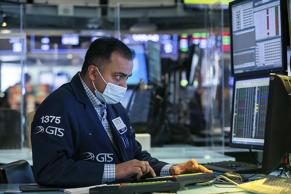 In this photo provided by the New York Stock Exchange, specialist Dilip Patel works on the floor, Wednesday, March 3, 2021, in New York. Stocks were mostly lower in afternoon trading as another tick up in bond yields gave investors pause. (Courtney Crow/New York Stock Exchange via AP)
