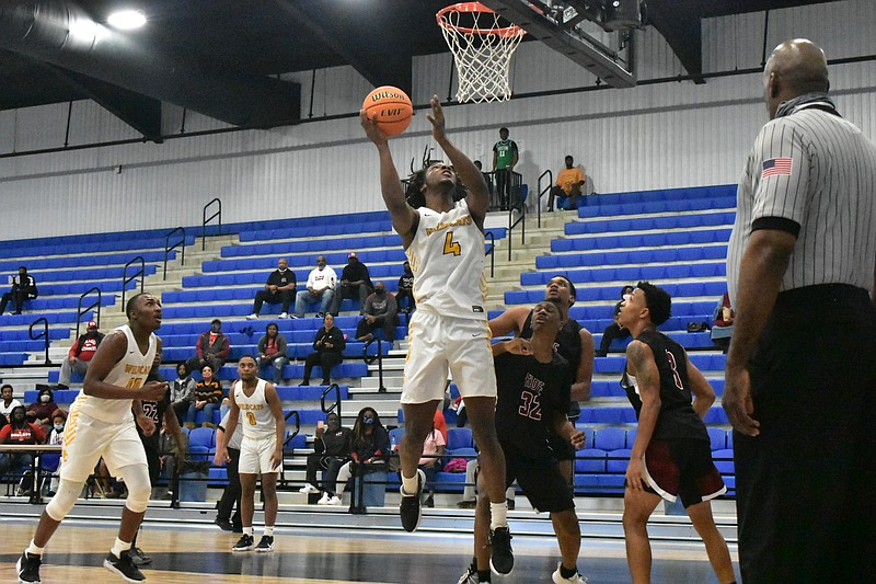 Antwon Emsweller (4) of Watson Chapel converts a second-chance basket and is fouled against Hope in the second half Thursday at the Star City High School arena. (Pine Bluff Commercial/I.C. Murrell)