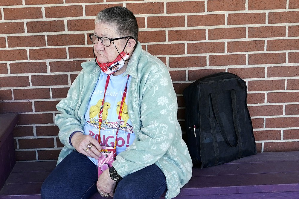 Pat Brown waits outside the Don Bosco Senior Center in Kansas City, Mo., Wednesday, March 3, 2021. Brown knows she needs the vaccine because her asthma and diabetes put her at higher risk of serious COVID-19 complications. But Wall hasn't attempted to schedule an appointment and didn't even know if they were being offered in her area yet; she says she is too overwhelmed. (AP Photo/Orlin Wagner)