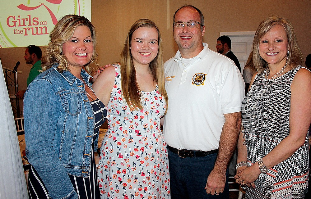 NWA Democrat-Gazette/CARIN SCHOPPMEYER Kalie Hollis, Girls on the Run scholarship recipient (second from left), is joined by her parents Kimbra Dearing and Travis Hollis (from left) and Tracey Montgomery at the Out of the Boc Luncheon on April 10 at Avondale Chapel and Gardens in Bentonville.