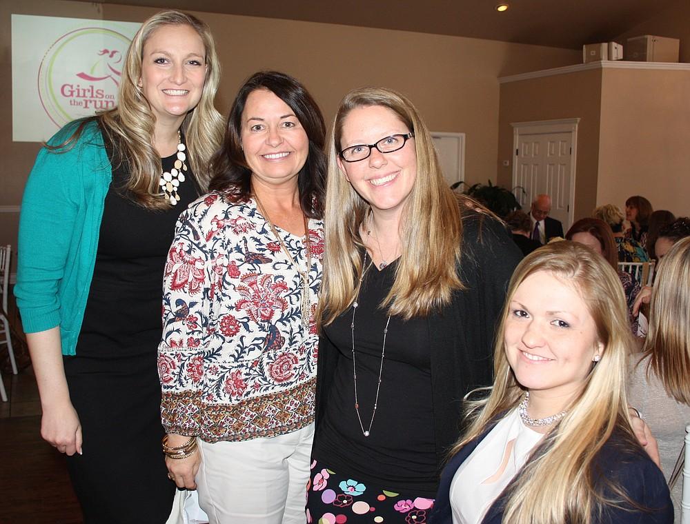 NWA Democrat-Gazette/CARIN SCHOPPMEYER Katie Duncan (from left), Melissa Berryhill, Jennifer Wills and Martha Bell help support Girls on the Run Northwest Arkansas.