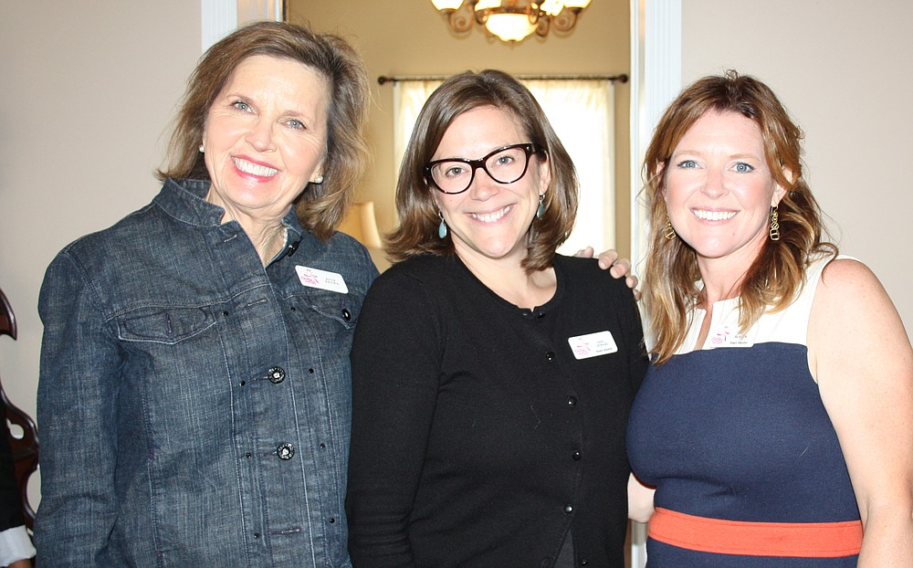 NWA Democrat-Gazette/CARIN SCHOPPMEYER Beth Brown (from left), Sara Leonard and Stacy Bigelow, Girls on the Run board members, welcome guests to the April 8 benefit luncheon.