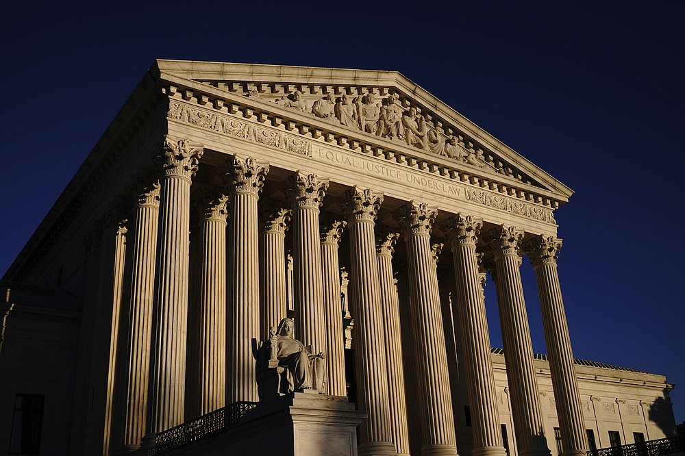 FILE - In this Nov. 2, 2020, file photo the Supreme Court is seen at sundown in Washington. President Joe Biden has two seats to fill on the influential appeals court in the nation's capital that regularly feeds judges to the Supreme Court. (AP Photo/J. Scott Applewhite, File)