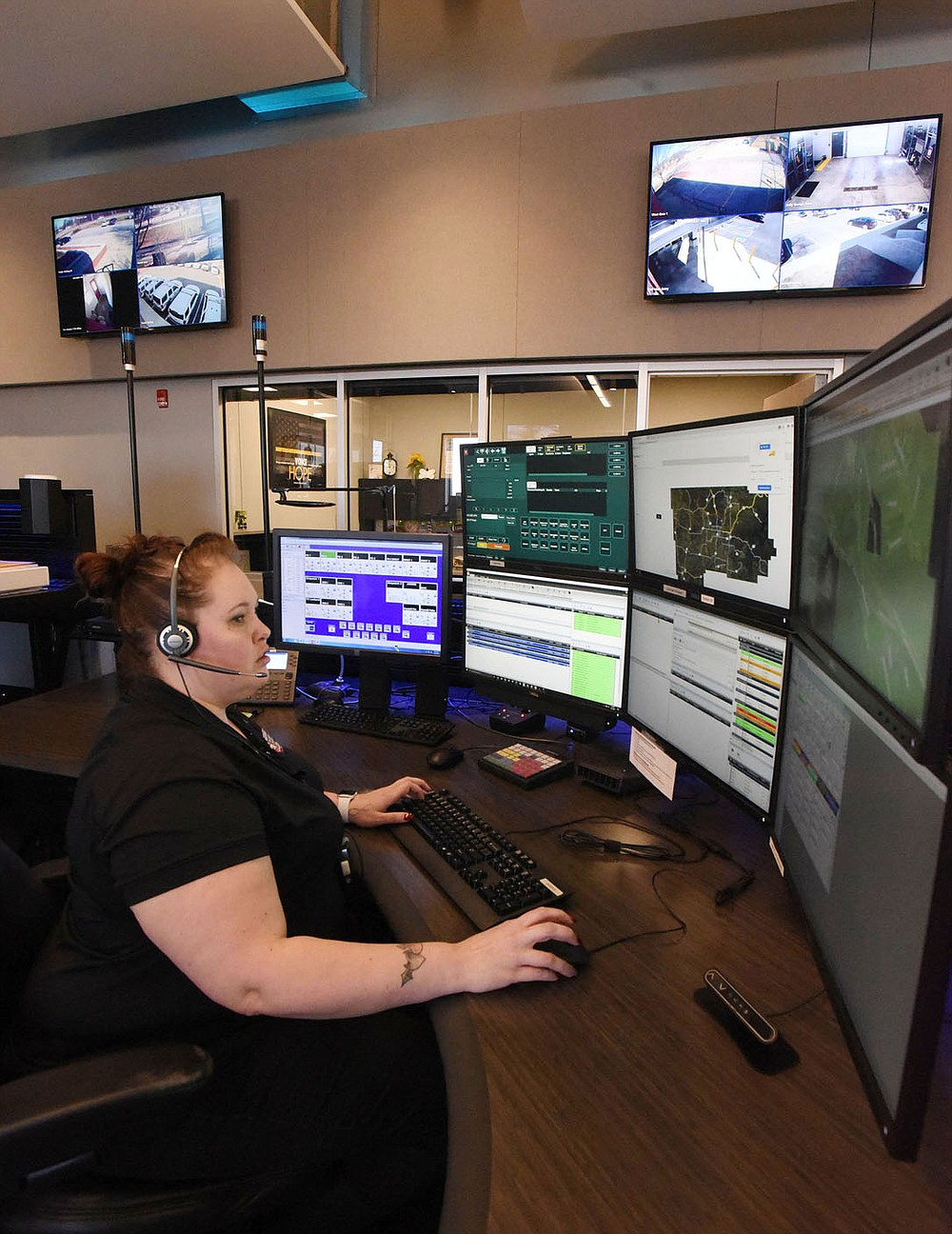 Desiree Beaver looks at information while on duty Tuesday March 2 2021 in the communications center at the Bentonville Police Department. A new radio system for the department is part of a $266 million bond issue residents will vote on on April 13. (NWA Democrat-Gazette/Flip Putthoff)