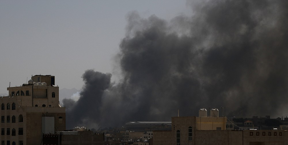 Smoke rises after Saudi-led airstrikes on an army base in Sanaa, Yemen, Sunday, Mar. 7, 2021. The Saudi-led coalition fighting Iran-backed rebels in Yemen said Sunday it launched a new air campaign on the war-torn country's capital and on other provinces. The airstrikes come as retaliation for recent missile and drone attacks on Saudi Arabia that were claimed by the Iranian-backed rebels. (AP Photo/Hani Mohammed)