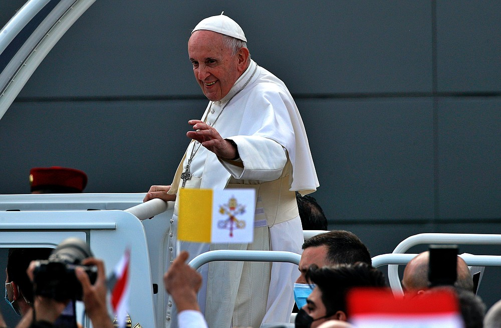 Pope Francis waves to faithful as he arrives for an open air Mass at a stadium in Irbil, Iraq, Sunday, March 7, 2021. Thousands of people filled the sports stadium in the northern city of Irbil for Francis' final event in his visit to Iraq: an open-air Mass featuring a statue of the Virgin Mary that was restored after Islamic militants chopped of the head and hands. (AP Photo/Hadi Mizban)