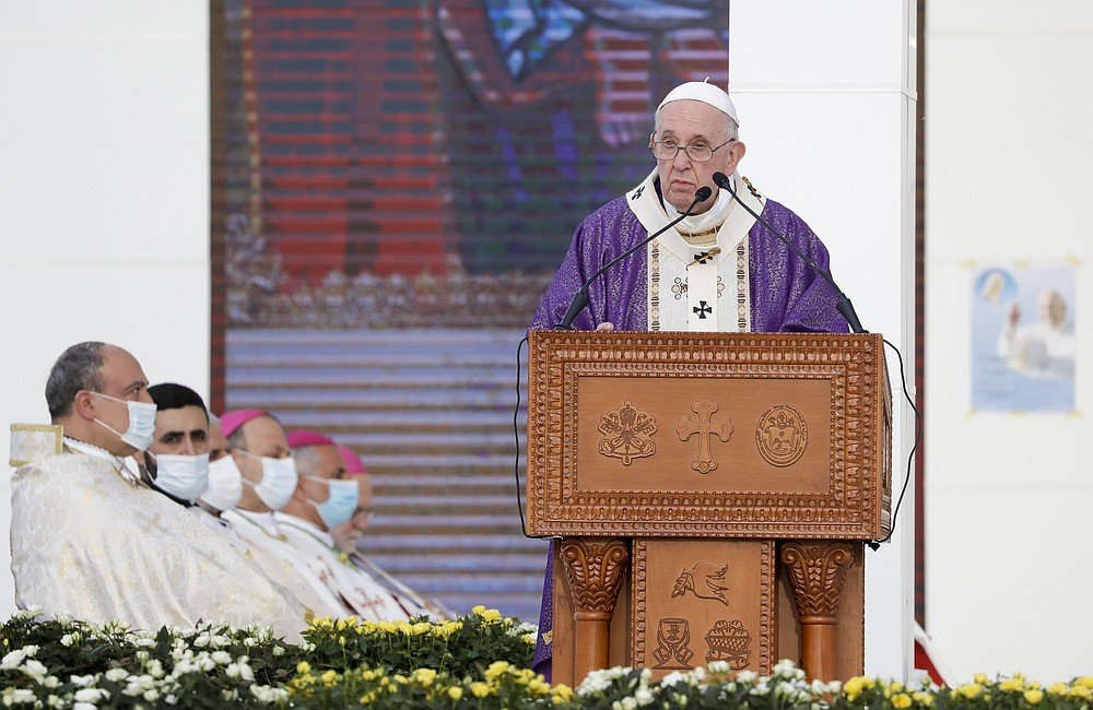 Pope Francis delivers his homily during a mass at the Franso Hariri Stadium in Irbil, Kurdistan Region of Iraq, Sunday, March 7, 2021. The Vatican and the pope have frequently insisted on the need to preserve Iraq's ancient Christian communities and create the security, economic and social conditions for those who have left to return.(AP Photo/Andrew Medichini)