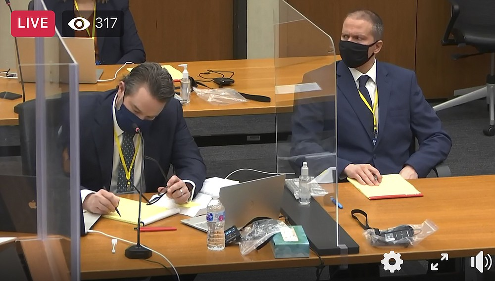 In this image taken from video, defense attorney Eric Nelson, left, and defendant, former Minneapolis police officer Derek Chauvin, right, listen as Hennepin County Judge PeterCahill presides over a hearing before jury selection, Monday, March 8, 2021, in Chauvin's trial at the Hennepin County Courthouse in Minneapolis, Minn. Chauvin is accused in the May 2020 death of George Floyd.   (Court TV/Pool via AP)
