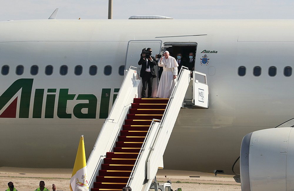 Pope Francis boards a plane upon concluding his visit to Iraq at Baghdad airport, Iraq, Monday, March 8, 2021. (AP Photo/Khalid Mohammed)