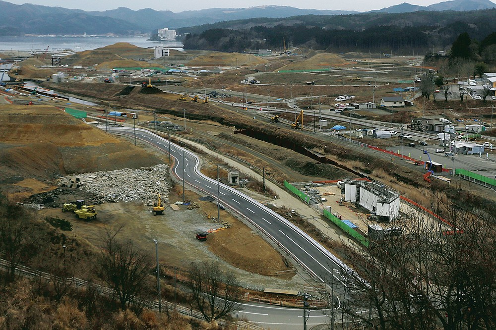 In this file photo dated March 7, 2016, construction work is being carried out in the flat town of Minamisanriku in Miyagi Prefecture in northeastern Japan almost five years after the March 11, 2011 tsunami.  (AP Photo / Eugene Hoshiko, File)