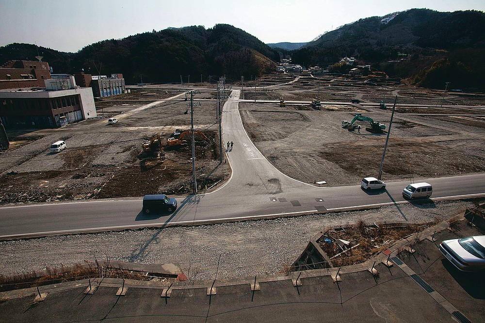 In this file photo dated February 22, 2012, two officers are walking down a street as the tsunami and earthquake devastated Onagawa City, Miyagi Prefecture, northern Japan.  (AP Photo / David Guttenfelder, file)
