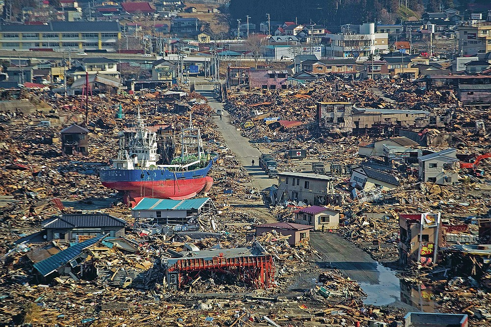 In this file photo dated March 28, 2011, a ship is in a destroyed residential area in Kesennuma, Miyagi Prefecture, northeastern Japan, after a strong tsunami hit the area on March 11th.  (AP Photo / David Guttenfelder, file)