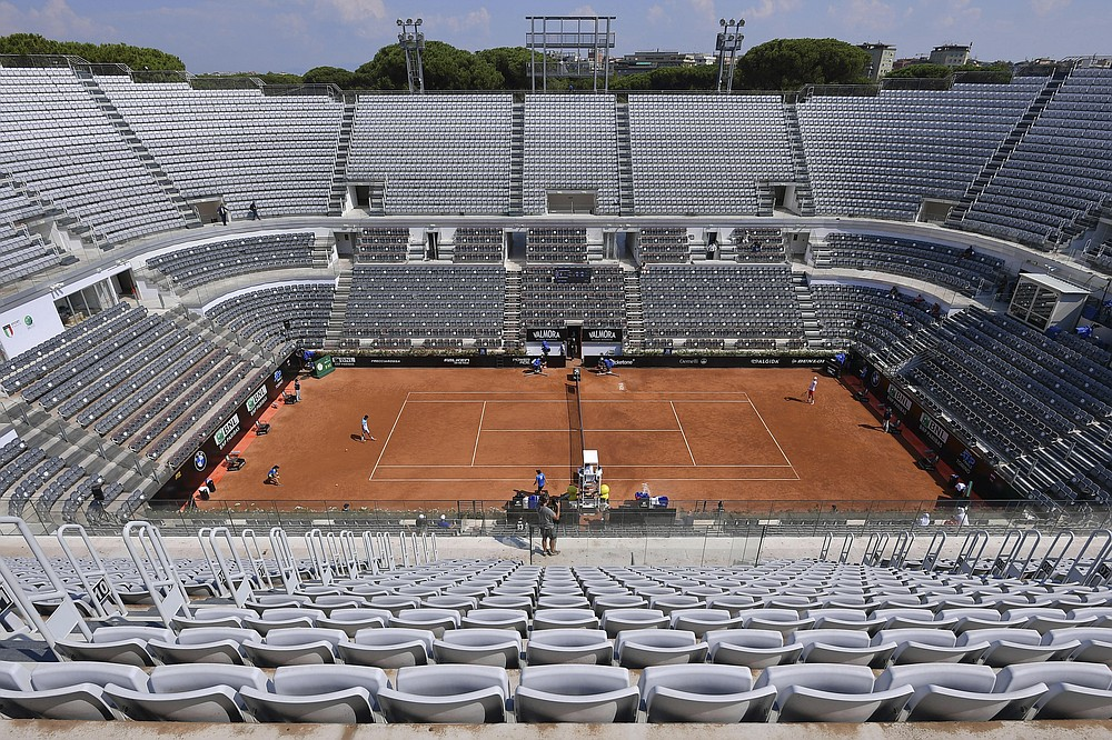 FILE - The stands around the Central Court of the Foro Italico are empty during a match between Serbia's Novak Djokovic and Italy's Salvatore Carus, at the Italian Open tennis tournament in Rome, in this Wednesday, Sept. 16, 2020, file photo.  (Alfredo Falcone/LaPresse via AP)