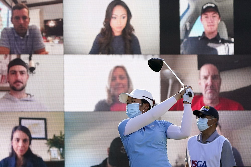 FILE - Jing Yan, of China, hits off the first tee as virtual fans, rear, look on during the first round of the U.S. Women's Open golf tournament in Houston, in this Thursday, Dec. 10, 2020, file photo. (AP Photo/Eric Gay, File)