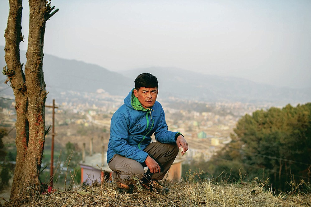 Pasang Rinzee Sherpa, 33, mountain guide poses for a photograph in Kathmandu, Nepal, Wednesday, March 3, 2021. Sherpa has scaled Mount Everest twice and spent 18 years helping climbers up the highest Himalayan peaks, generally earning about $8,000 a year. In the past 12 months, he had no income. (AP Photo/Niranjan Shrestha)