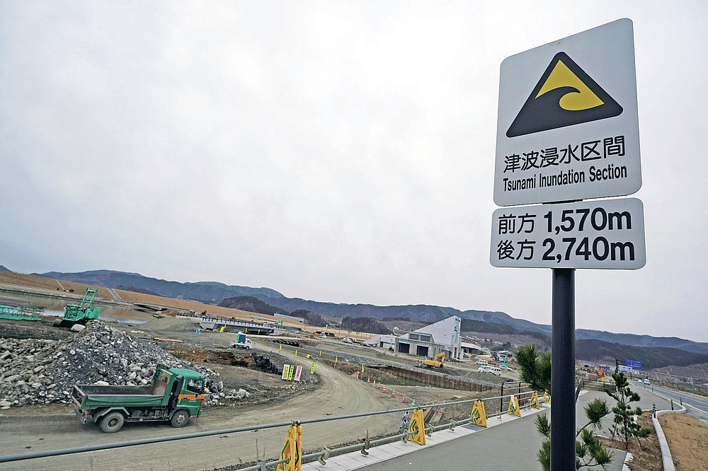 A tsunami inundation sign is seen at an area destroyed by the 2011 tsunami in Rikuzentakata, Iwate Prefecture, Friday, March 5, 2021. In Rikuzentakata more than 1,700 people died by the March 11, 2011 disaster. (AP Photo/Eugene Hoshiko)
