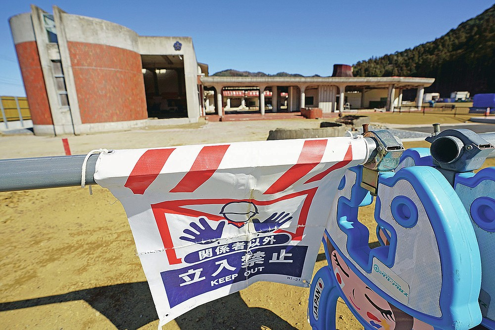 Former Okawa Elementary School where 74 children from the school lost their lives along with 10 teachers by a massive tsunami in 2011, is seen in Ishinomaki, Miyagi Prefecture, northern Japan Saturday, March 6, 2021. The elementary school was decided to preserve reminders of the March 11, 2011, disaster. (AP Photo/Eugene Hoshiko)