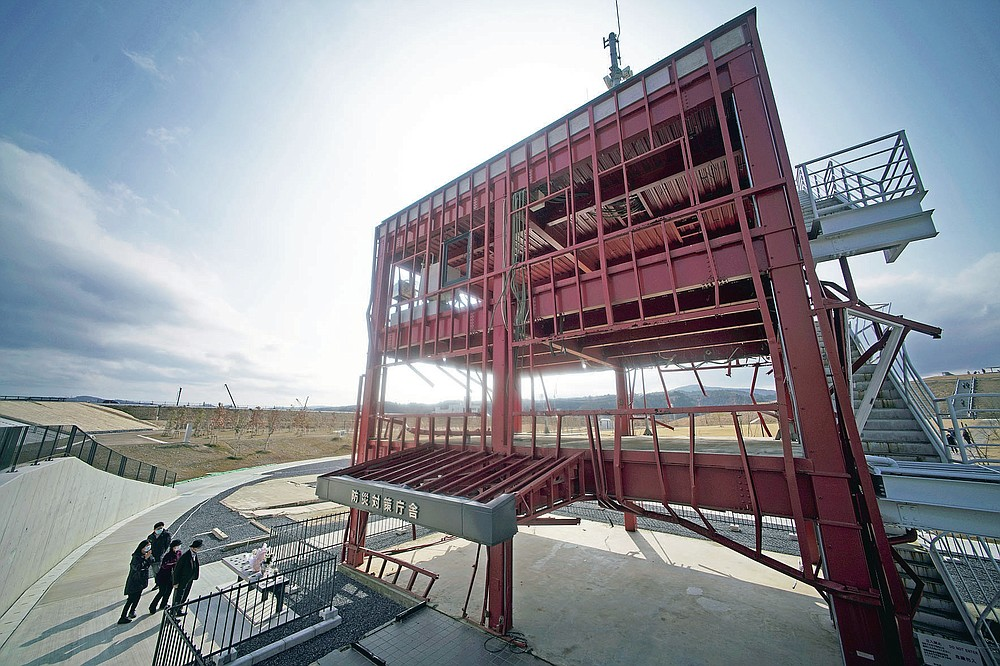 The skeleton of the tsunami-damaged disaster prevention headquarters where 43 workers died as the tsunami washed over it, is seen in Minamisanriku, Miyagi Prefecture, northern Japan, Saturday, March 6, 2021. The three-story building is one of legacies that still stand in northern Japan's coastal towns, 10 years after the earthquake and tsunami that killed more than 18,000 people. (AP Photo/Eugene Hoshiko)