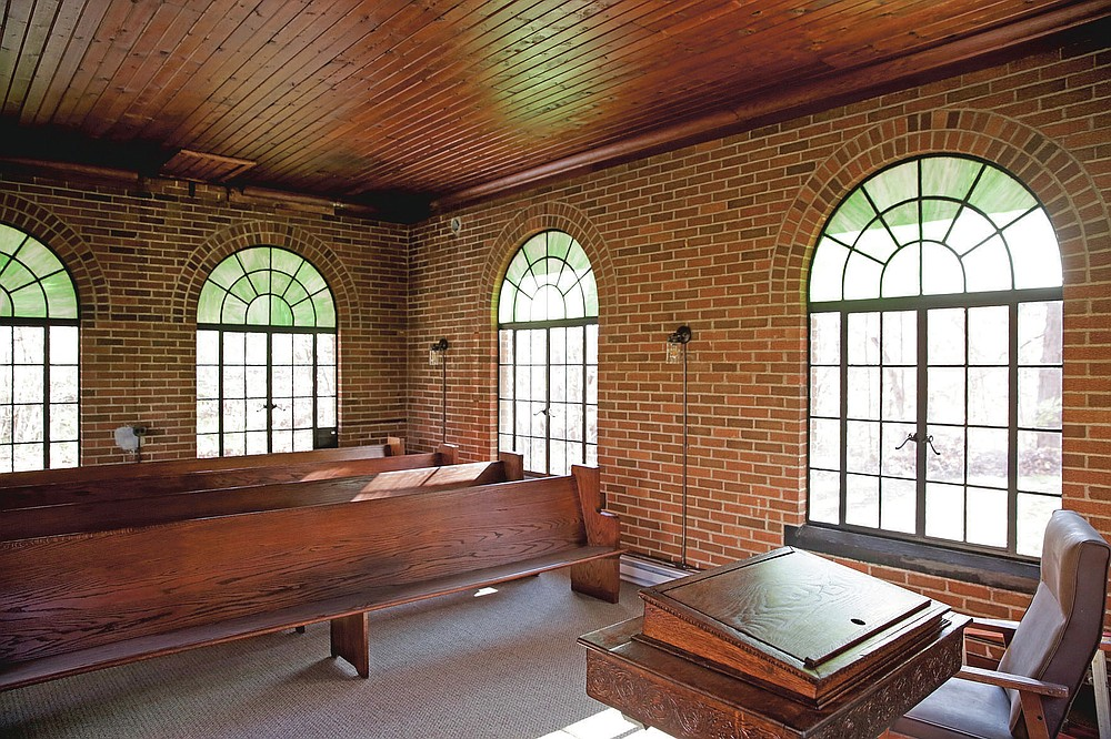 The interior of the newly renovated Indiana Veterans' Home chapel is seen Friday, Nov. 6, 2020, in West Lafayette, Ind. The small chapel, built in 1932, was utilized by the Indiana State Soldier's Home Cemetery for years as a space for funerals, weddings, religious services and other activities. But over the years, it fell out of use and into disrepair. (Nikos Frazier/Journal & Courier via AP)
