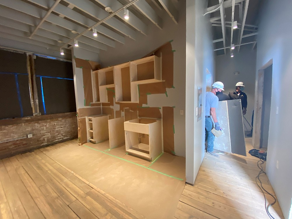 The sheetrock is dry and the East Harding Construction crew is working on the finishing touches of The ARTworks on Main's five apartments and five work studio spaces. (Special to The Commercial/Deborah Horn)