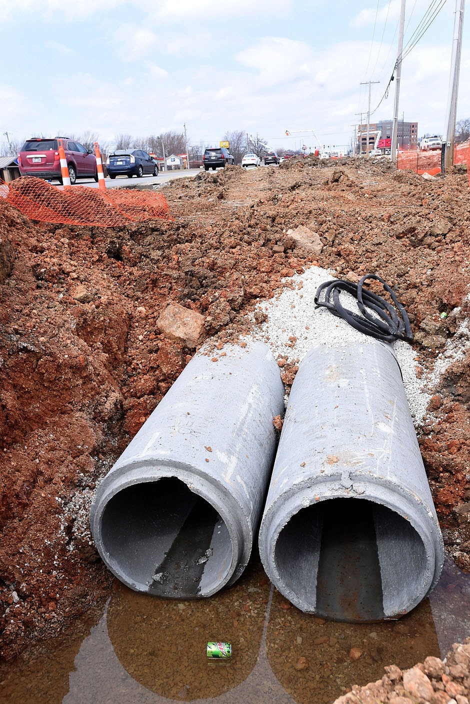Drainage work is ongoing Tuesday March 9 2021 along Walton Boulevard south of the Walmart Home Office.  (NWA Democrat-Gazette/Flip Putthoff)