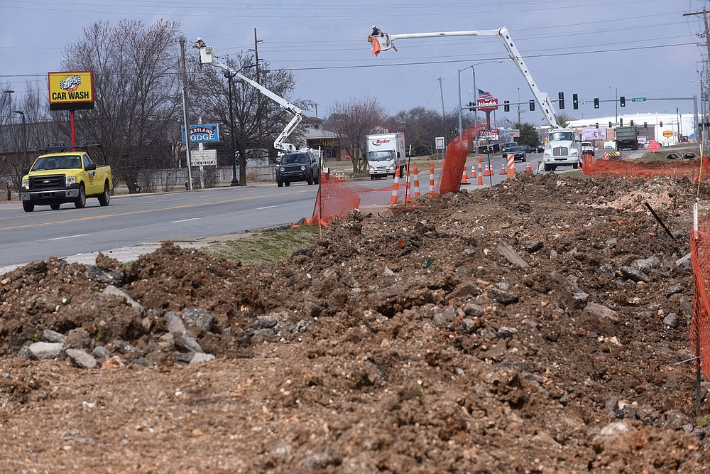 Drainage work is ongoing March 9 2021 along Walton Boulevard south of the Walmart Home Office.  (NWA Democrat-Gazette/Flip Putthoff)