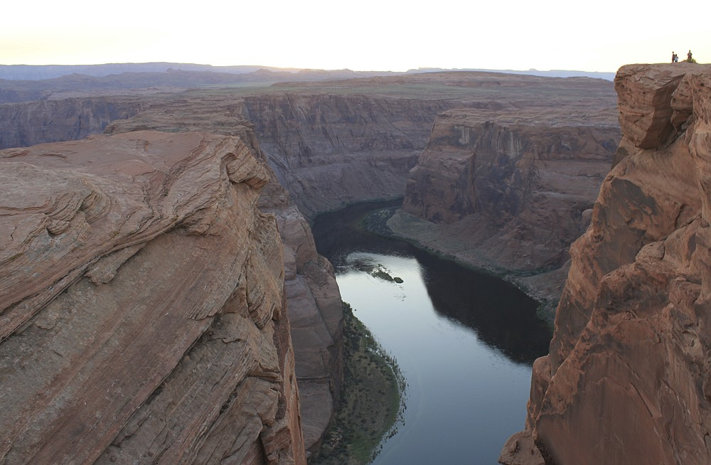 This Aug. 20, 2019 image shows the Colorado River flowing south of Page, Arizona. A plan by Utah could open the door to the state pursuing an expensive pipeline that critics say could further deplete Lake Powell, which is a key indicator of the Colorado River's health. (AP Photo/Susan Montoya Bryan)